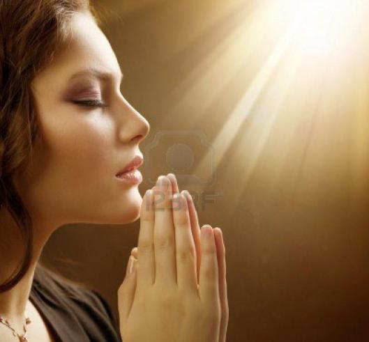 9212066-praying-woman-retro-styled-soft-focus